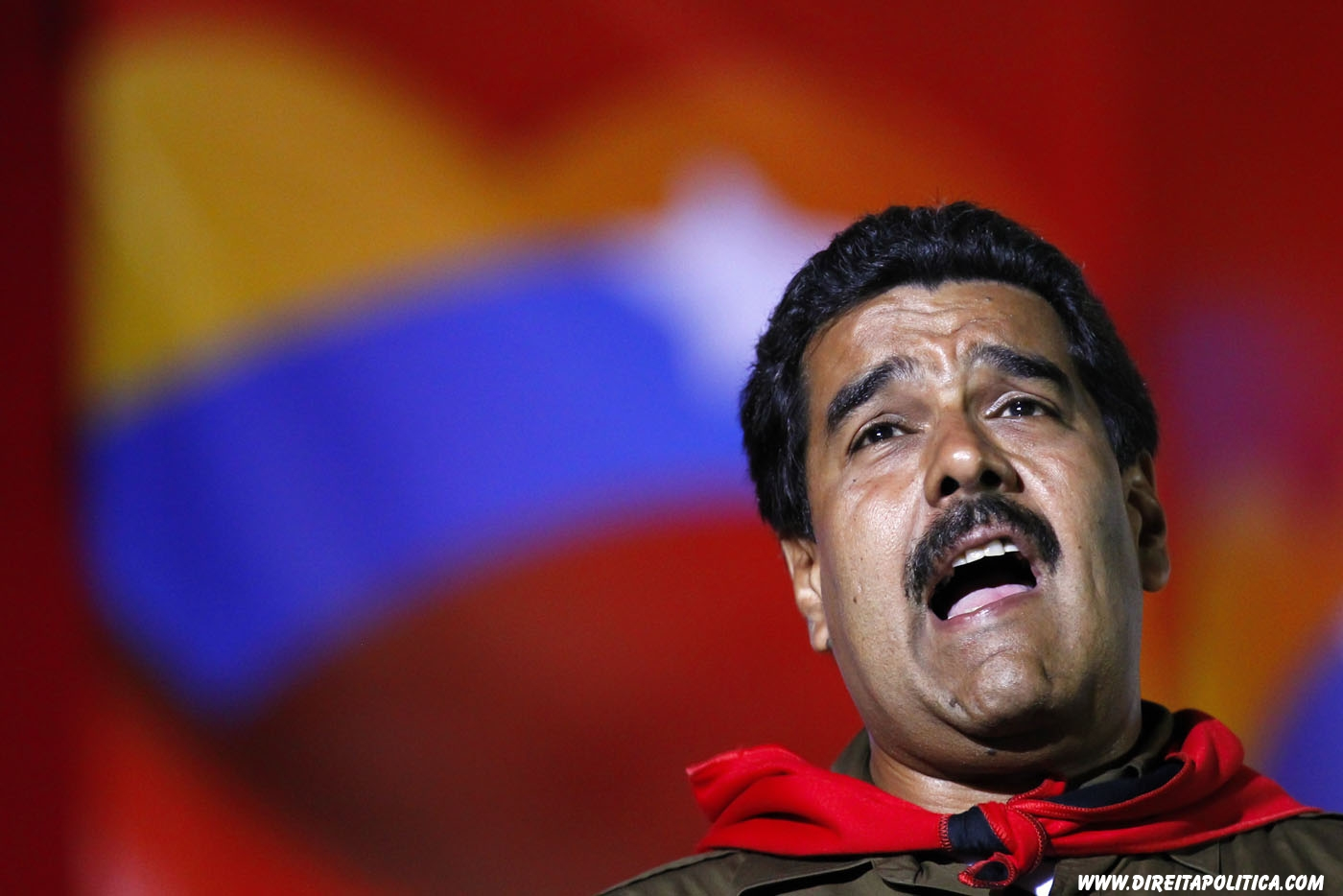 Venezuela's acting President and presidential candidate Nicolas Maduro sings during a campaign rally in Caracas April 5, 2013. Maduro said on Friday that Venezuelan authorities have arrested several people suspected of plotting to sabotage one of his campaign rallies before an April 14 election by cutting the power. REUTERS/Carlos Garcia Rawlins (VENEZUELA - Tags: POLITICS ELECTIONS)